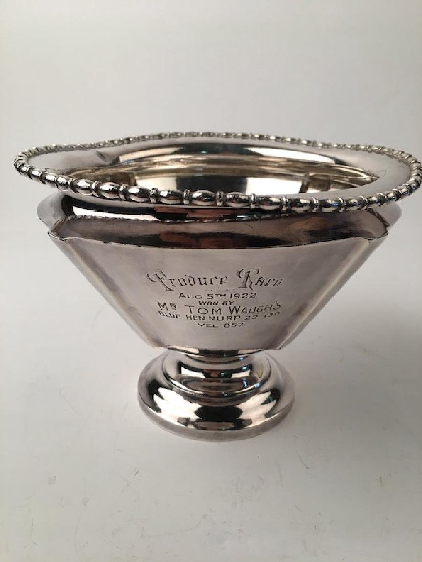 Tom Waugh trophy silver plate trophy cup. Monogramed