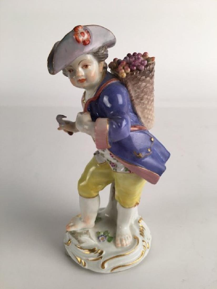 Meissen figure of a young boy with a sickle and a