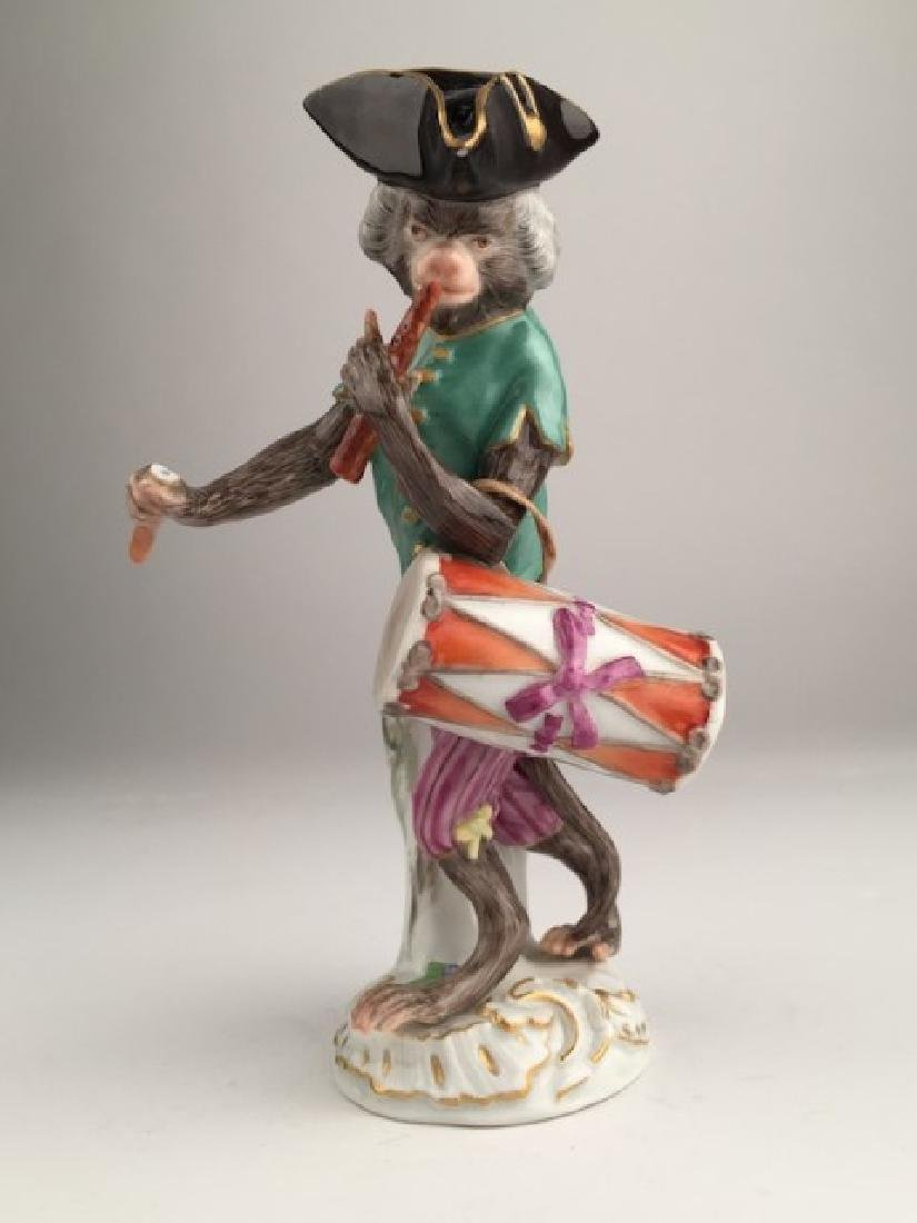 Meissen monkey band member playing a drum. Properly