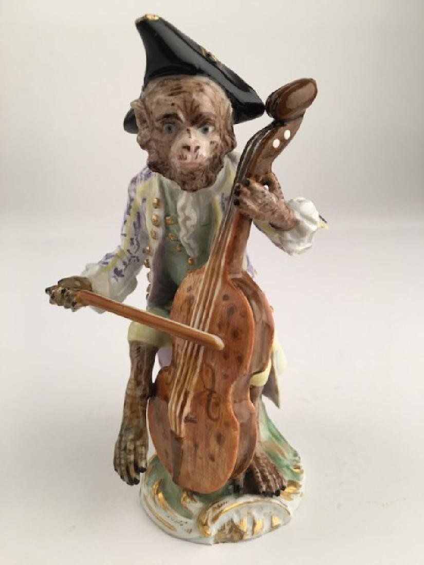 Meissen monkey band member playing a cello.