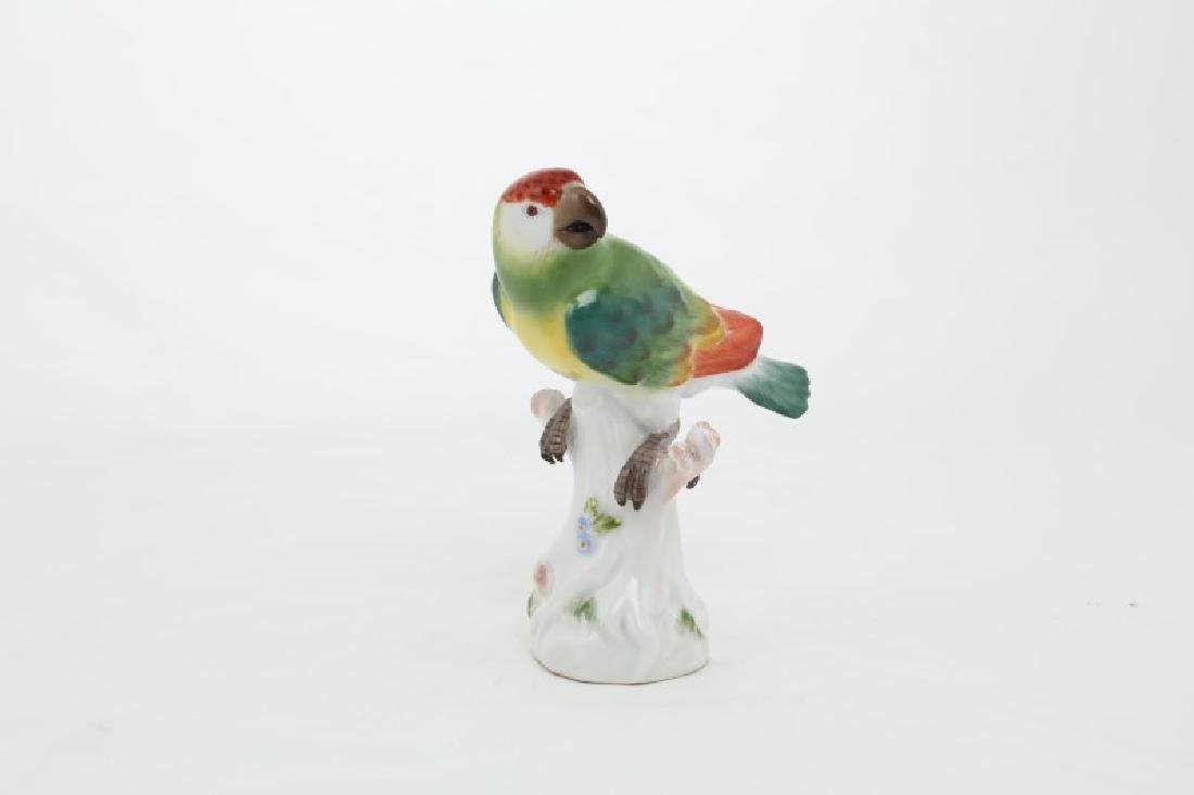 Meissen porcelain bird perched on a stump.
