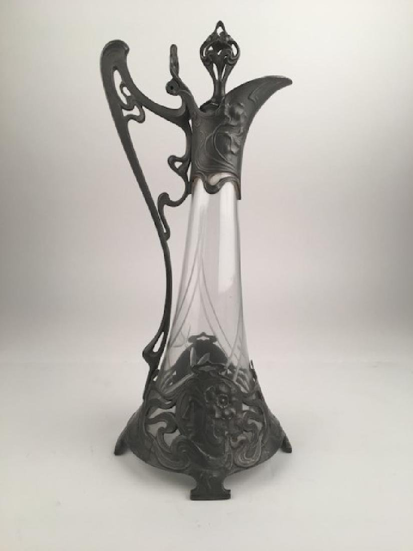Pewter and glass art nouveau claret jug. Overall height
