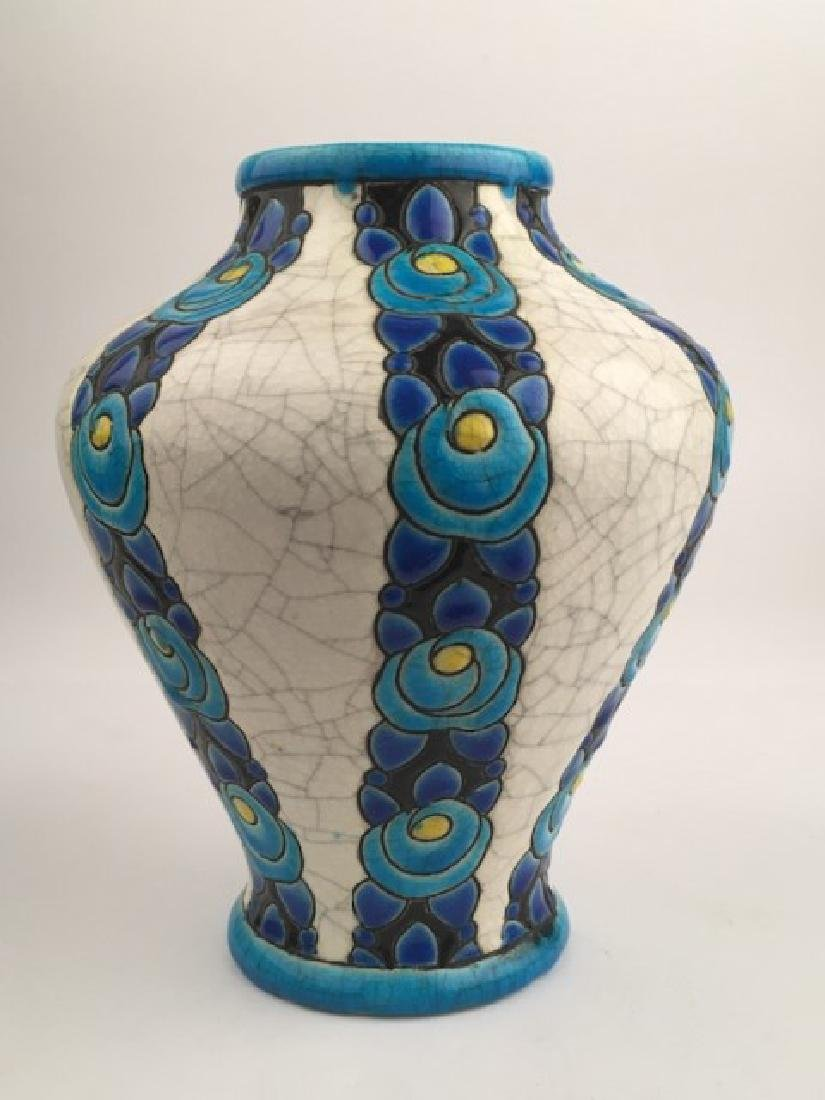 Keramis pottery vase with stylized flowers.
