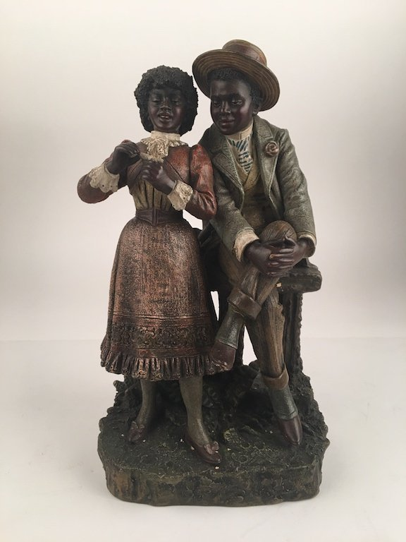 Antique terracotta figure of a well dressed couple