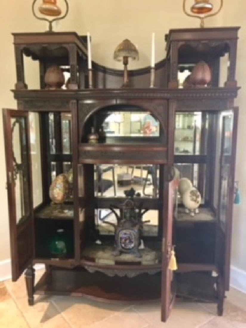 Antique  walnut  beveled glass display cabinet with