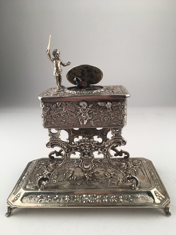 A sterling silver mechanical singing bird box with a