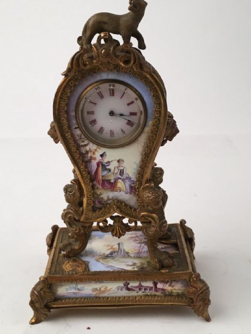 Antique painted enamel minature clock with a lion on