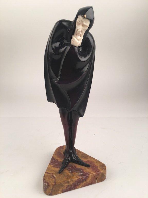 "Bronze  sculpture entitled ""Mephisto""."