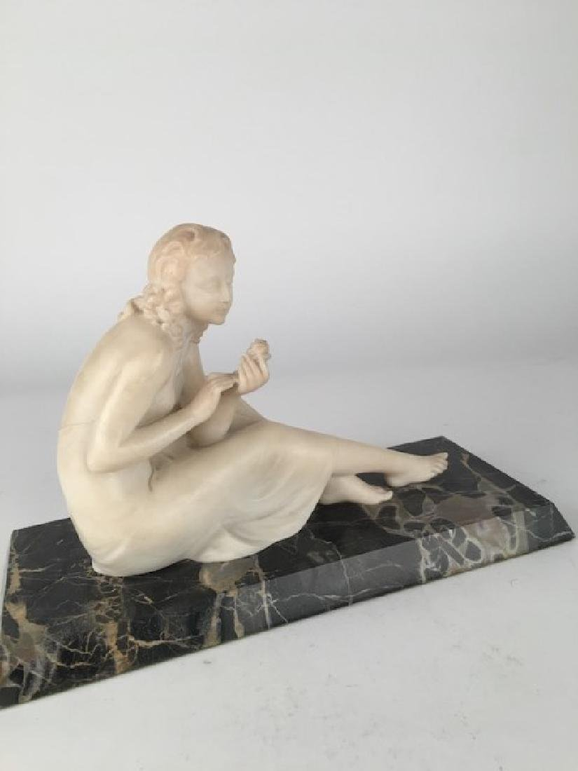 Alabaster carved figure of a Victorian lady looking at