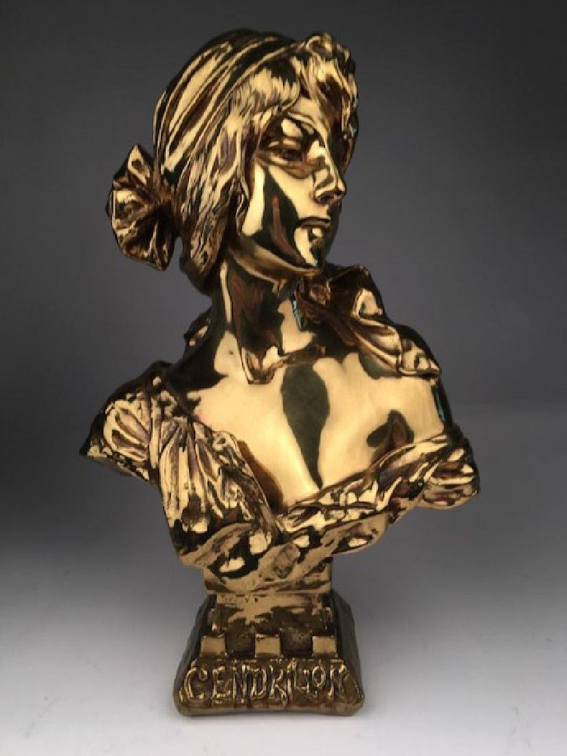 """""""Cendrillon"""" a gold painted bronze bust."""