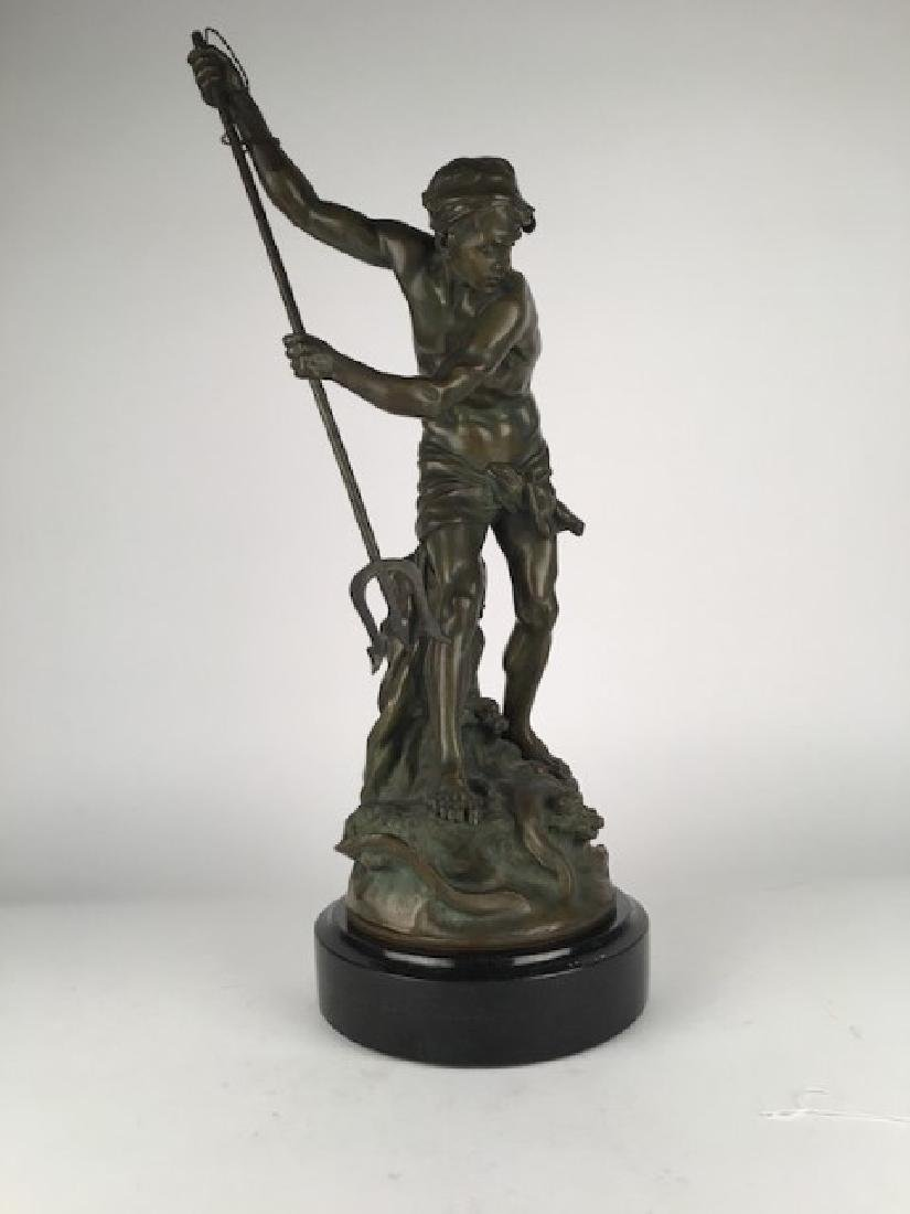 A. Gaudez bronze figure of a man with spear.