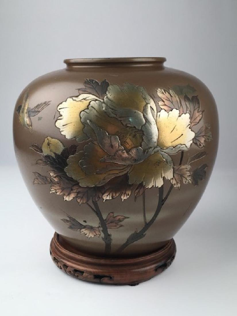 Meiji period mixed metal jar on a reticulated carved
