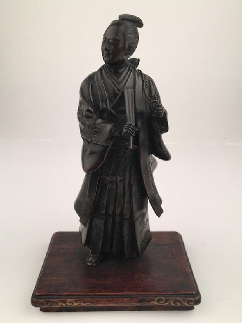 Miyao Japanese mixed metal figure of a man stoning a