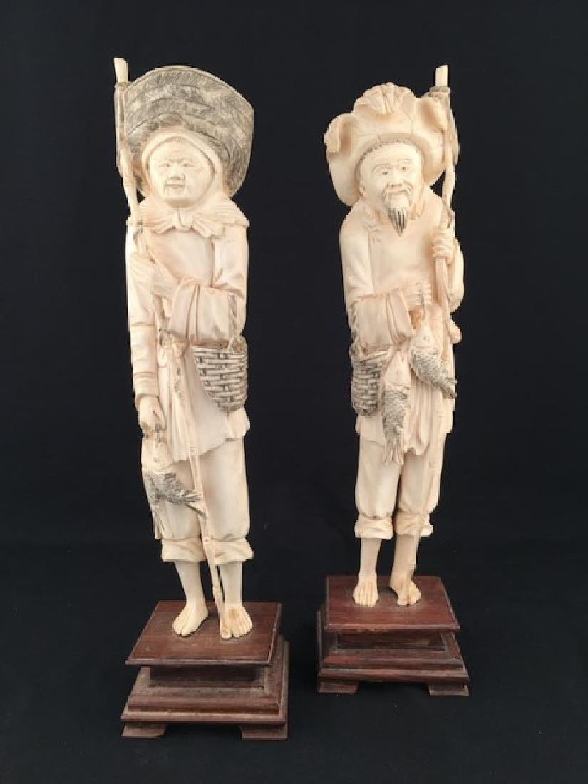 CIrca 1880 pair of carved  fishers, each figure with a