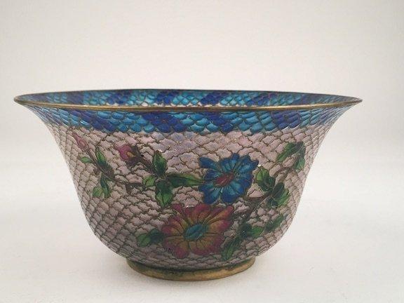 A plique-a-jour translucent enamel bowl decorated with