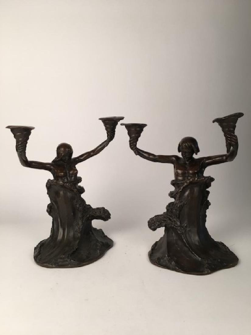 A pair of Art Nouveau bronze candalebras. Attributed to