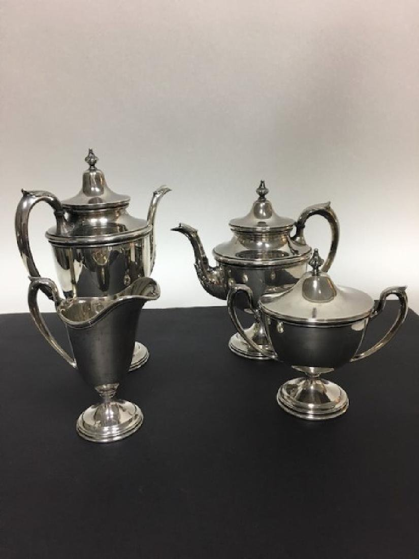 Four piece sterling silver tea set,