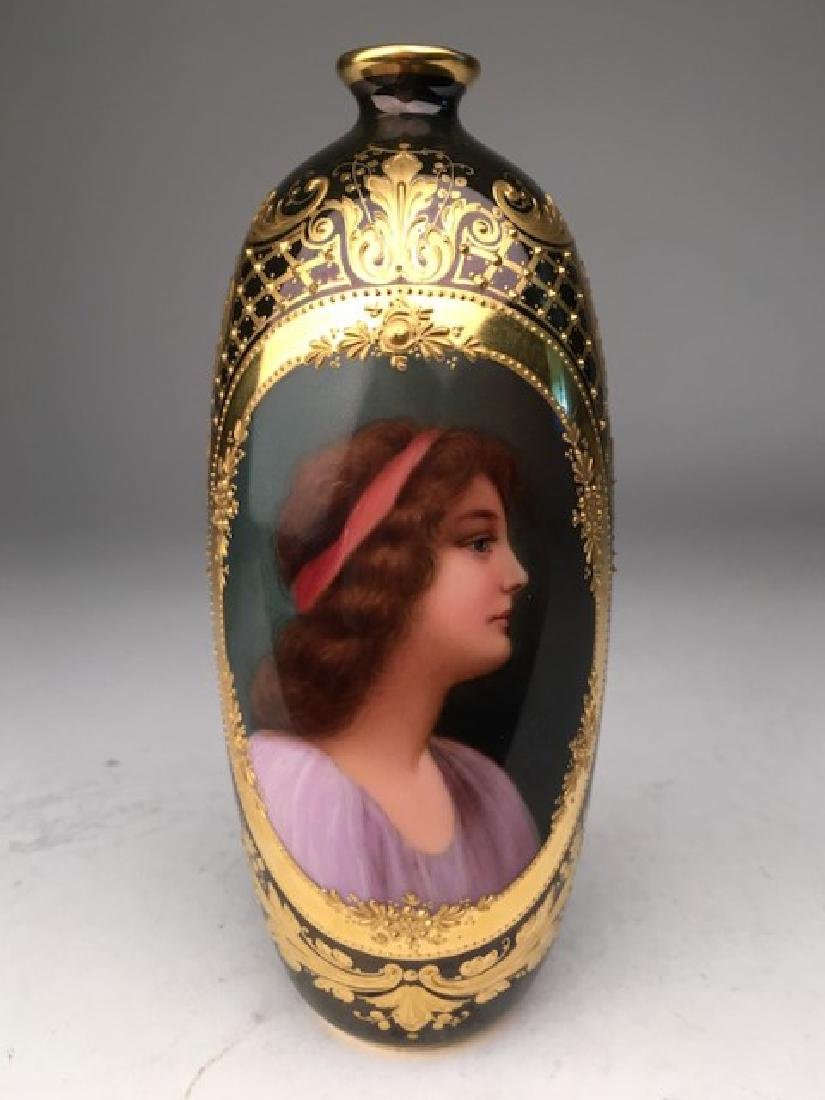 Royal Vienna portrait bud vase with gold enamel on a