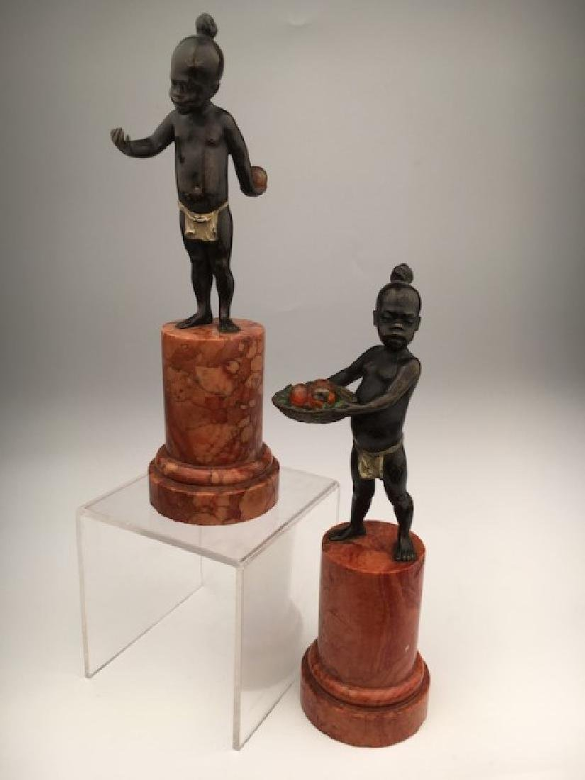 Two Berman bronze figures on base.