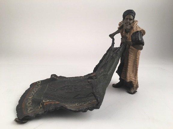 Bergman bronze figurine of a carpet seller. Marked