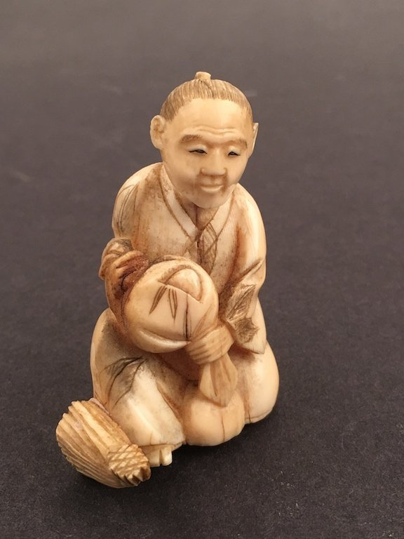 Carved  figure of a man with a sack.