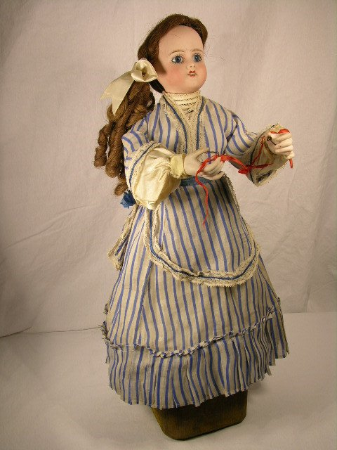 3101:  AUTOMATON DOLL WITH BISQUE HEAD