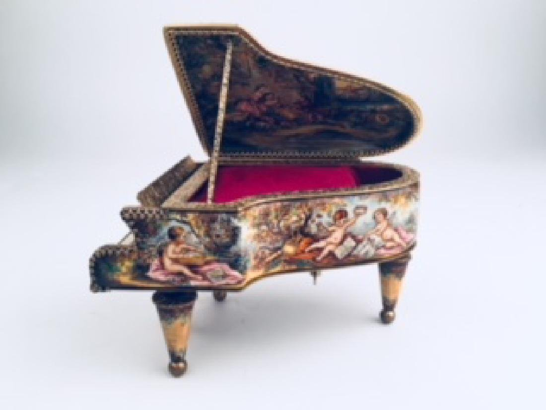 Viennese enameled painted musical box as a grand piano.