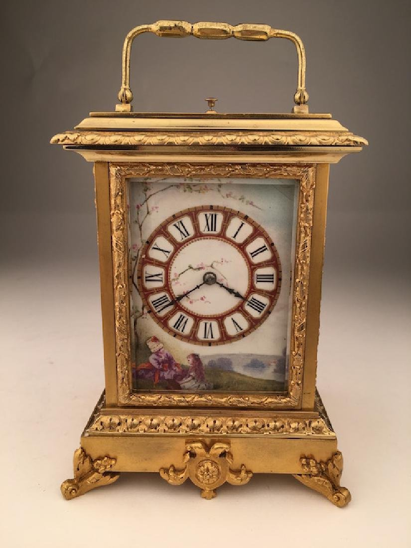 French gold gilt repeater clock with painted porcelain