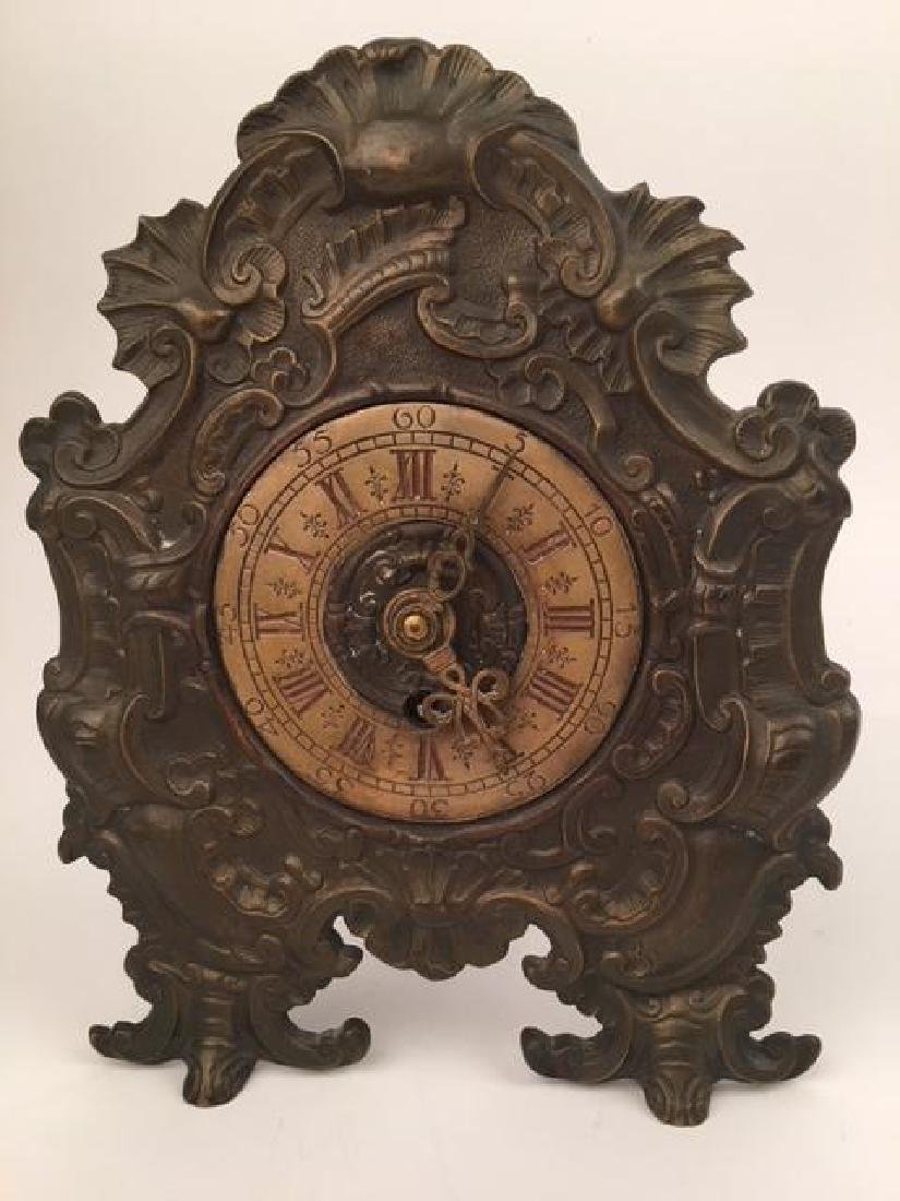 Antique bronze clock with foliate frame. Height 9 3/4
