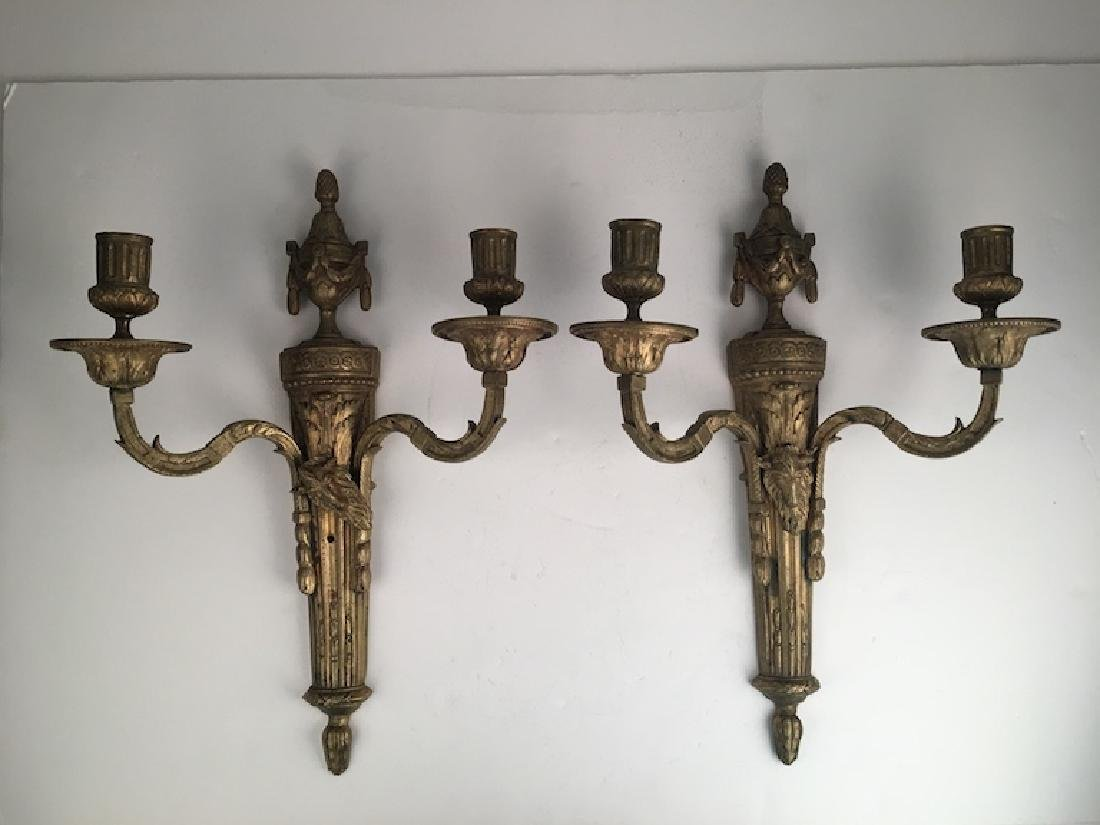 A pair of French Empire bronze wall scones. Length 15