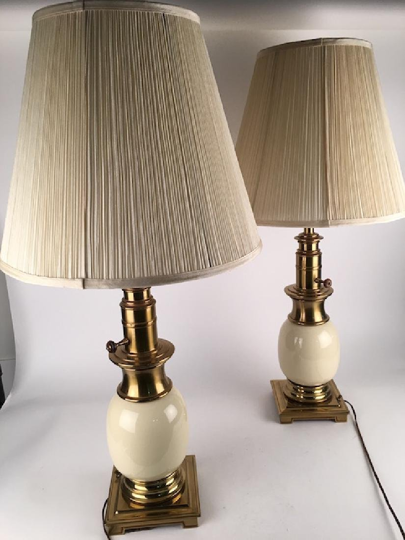 A pair of vintage porcelain and brass table lamps.