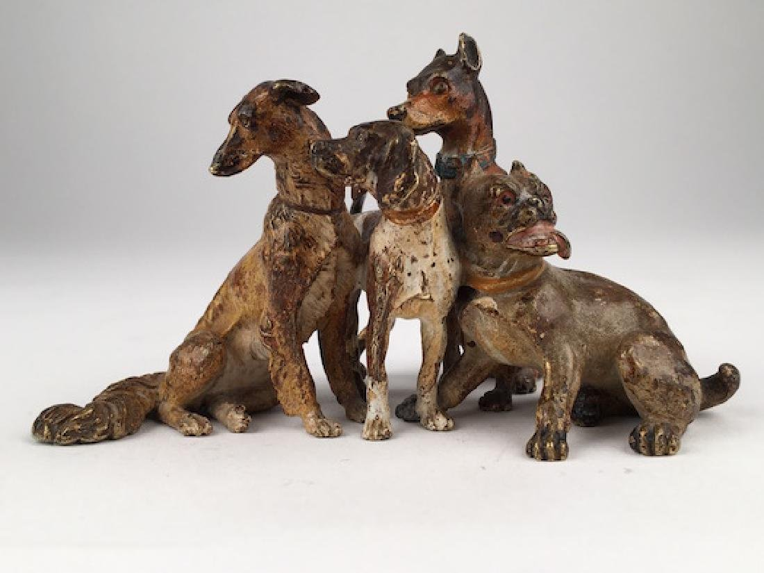 Antique Vienna cold painted bronze figure of four dogs.
