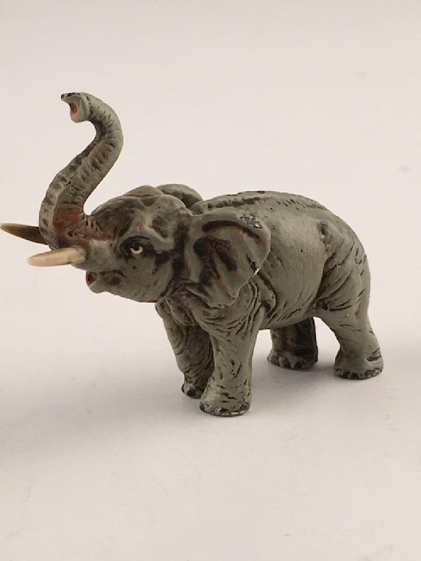 A small Vienna bronze elephant with their tusk up.
