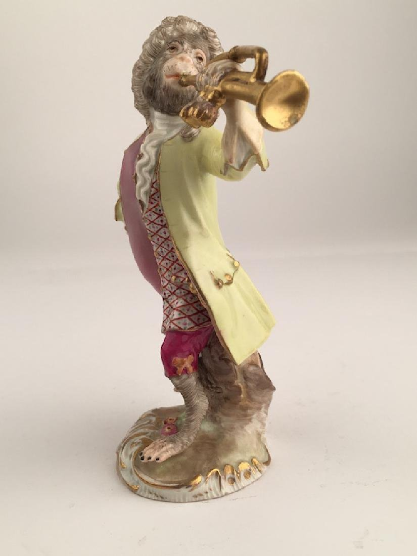 Meissen monkey band member playing a trumpet.