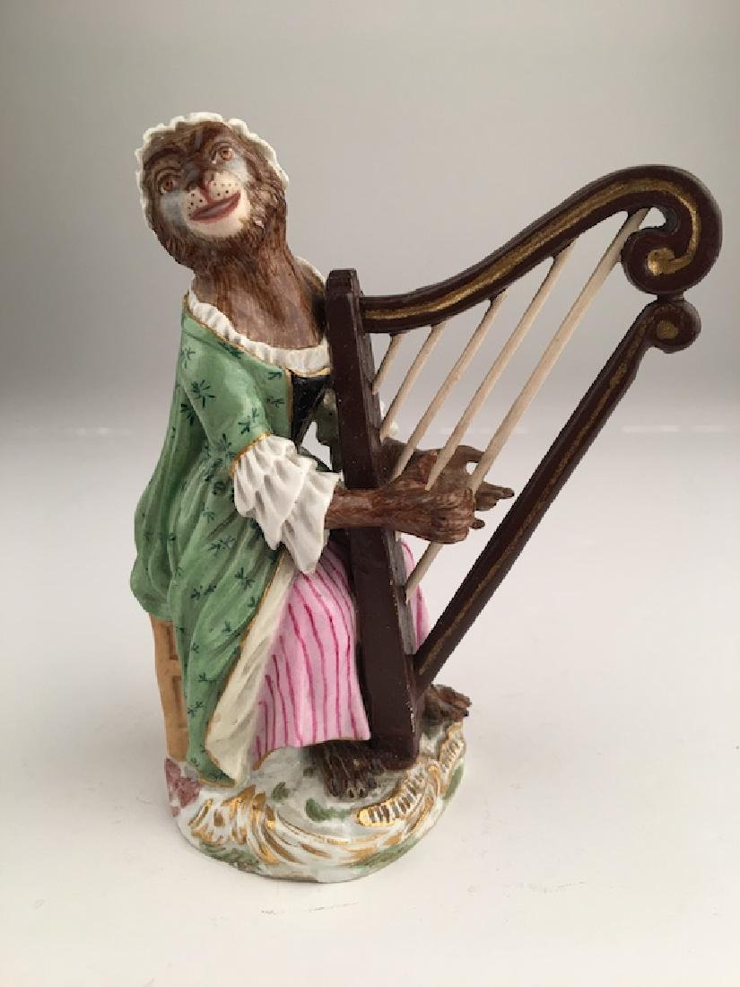 Meissen monkey band member seated playing a harp.