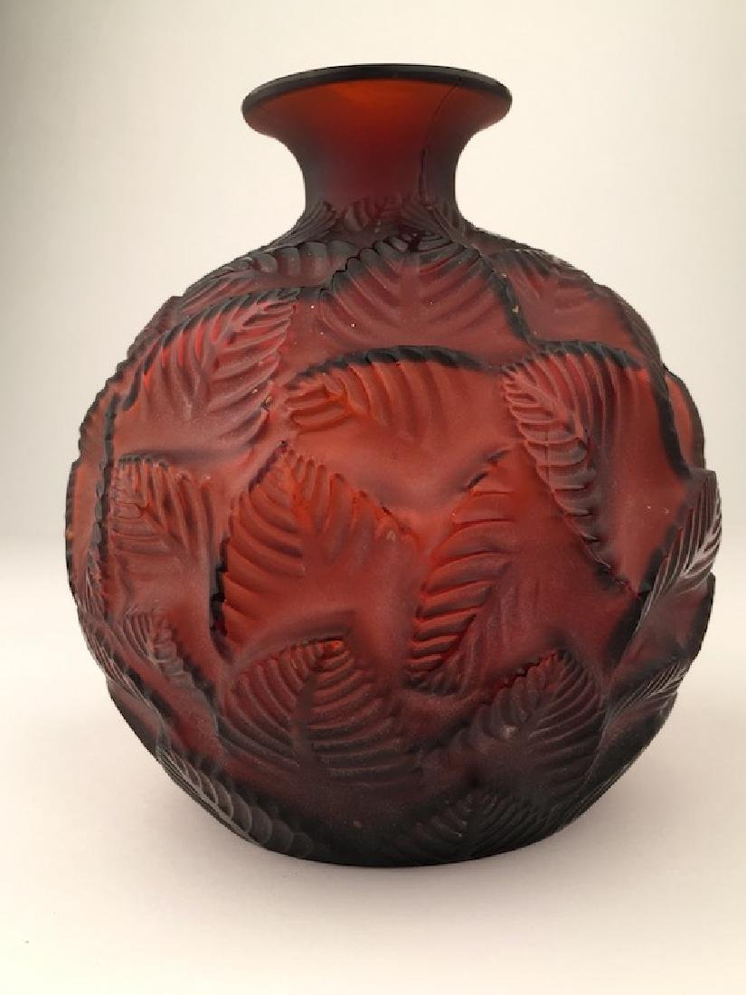 """Rene Lalique """"0rmeaux"""" vase in red glass with a design"""