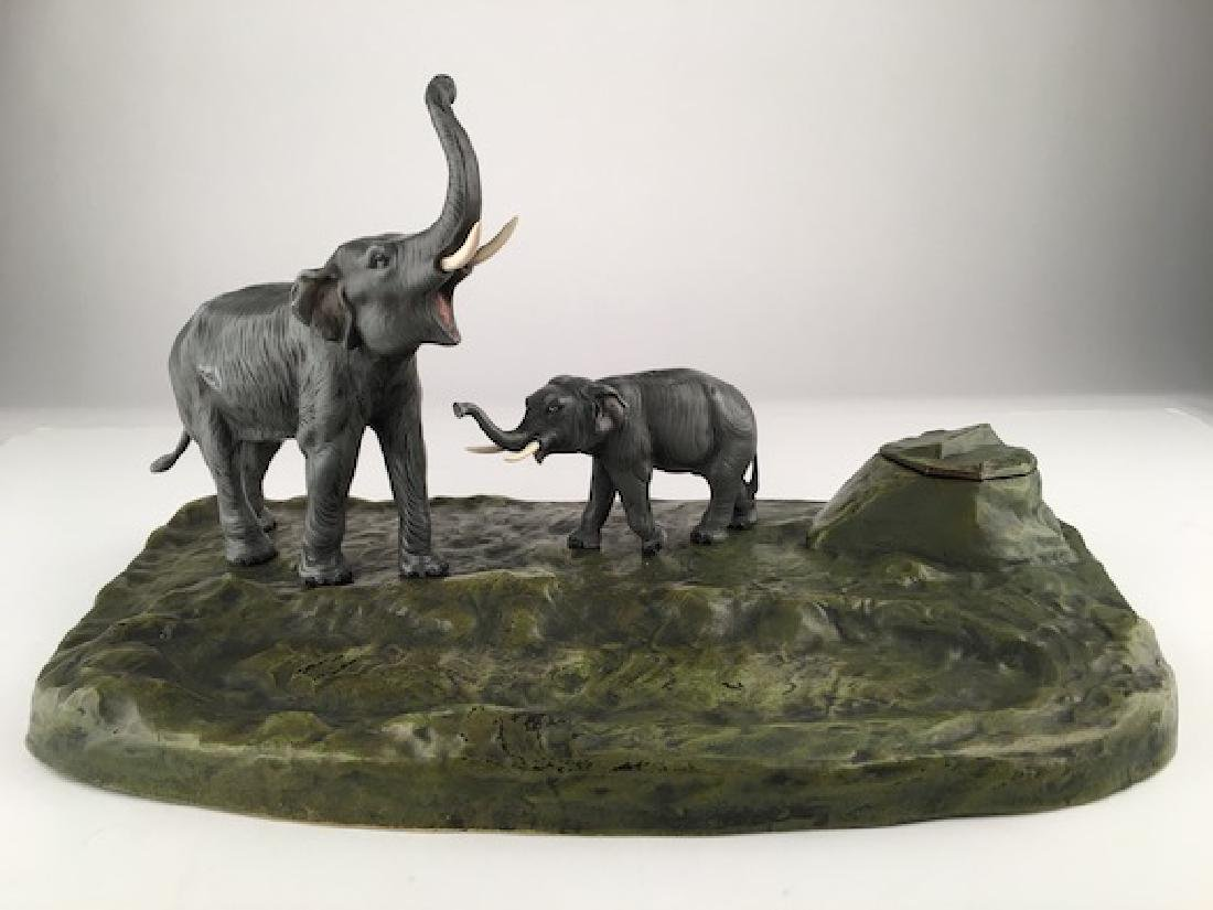 A cold painted ink well with two standing elephants