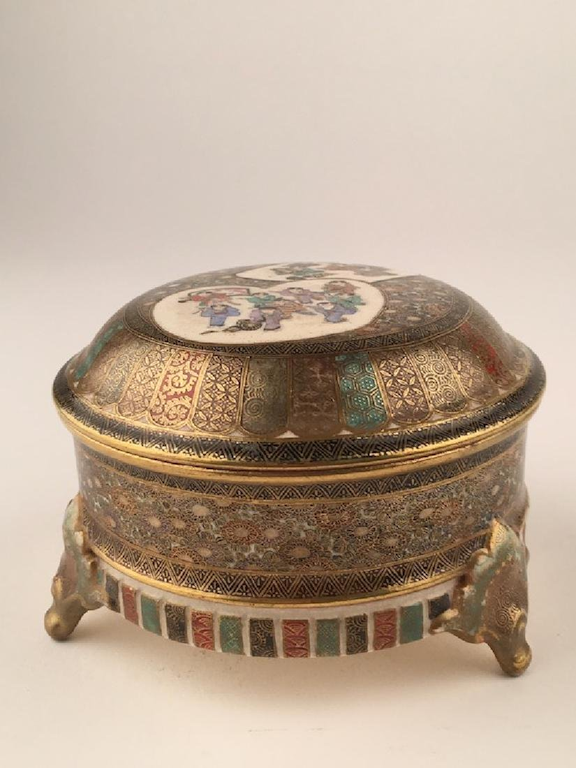 A Satsuma three scrolled footed round box,