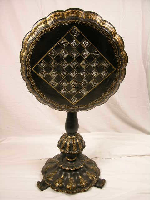 3139: PAPER MACHE TILT TOP TABLE.DECORATED WITH A CHESS