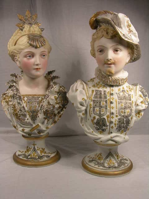 3144: A PAIR OF BISQUE FIGURES.A PAINTED PAIR OF ROYAL