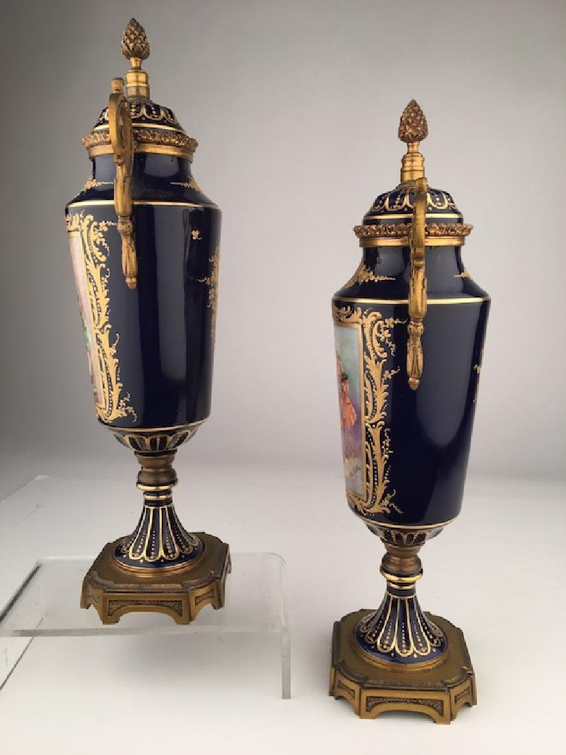 Pair of Sevres urns with gold dore bronze handles and - 5