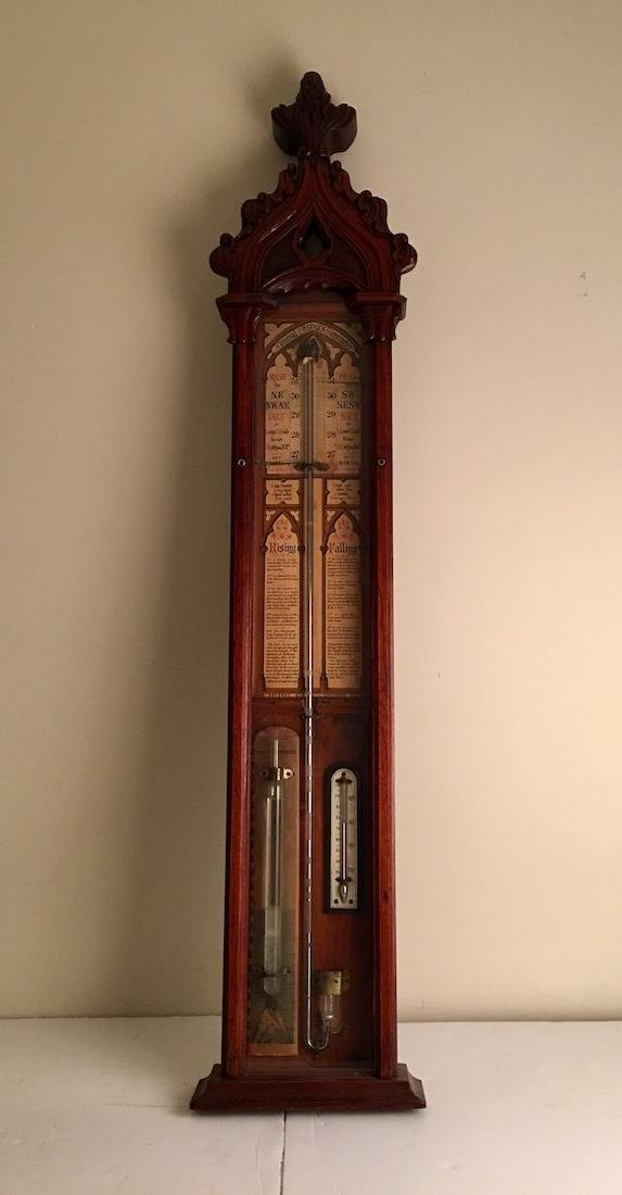 Antique English barometer in a mohogony wood case.