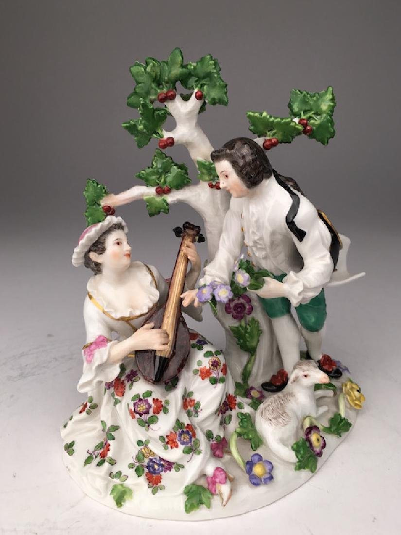 Meissen figurine of a lady playing music to a man