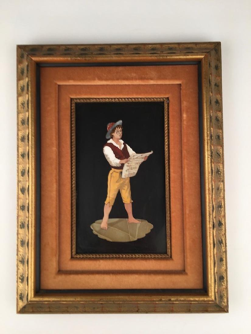 Framed pietra dura plaque of a man reading a paper.