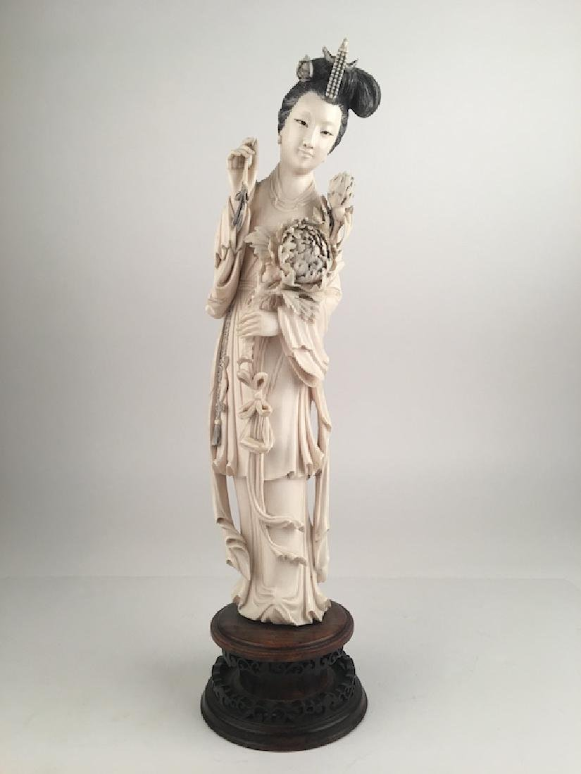 Large carved beauty holding a Lotus flowers. Mounted on