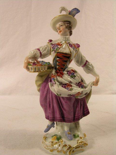 3505: MEISSEN PORCELAIN FIGURE OF A WOMAN HOLDING A BAS