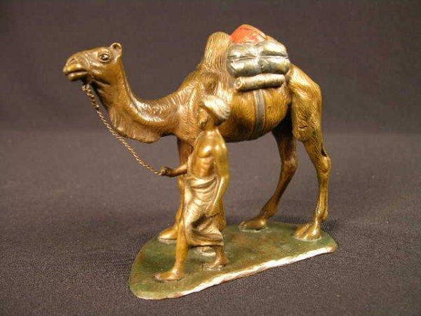 3801: BRONZE BERGMAN ARAB FIGURE OF A MAN WITH CAMEL.