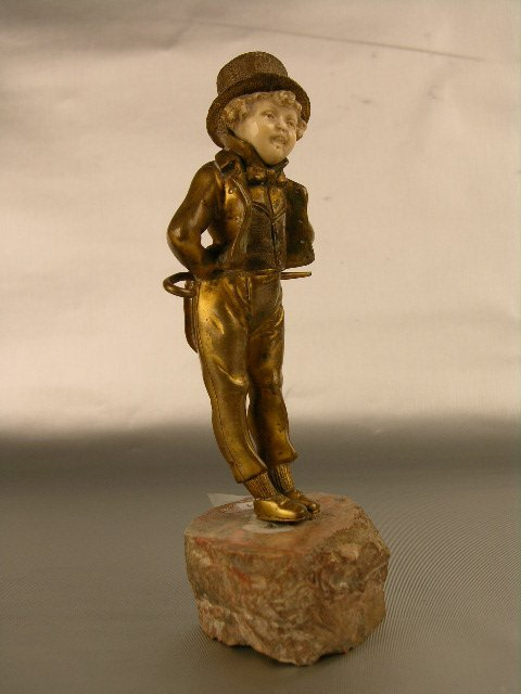 3807: BRONZE AND IVORY FIGURINE OF A YOUNG BOY .
