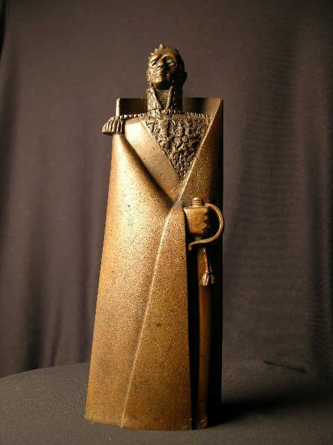 3817: BRONZE SCULPTURE OF A STYLIZED MAN WITH A SWORD