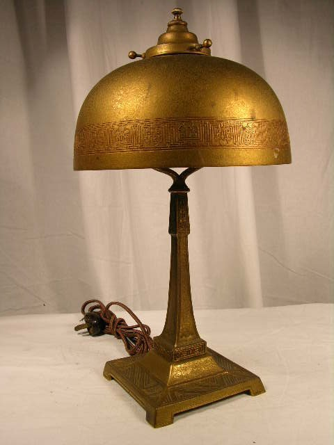 4074: TIFFANY GILT BRONZE DESK LIGHTING AND SHADE.IN TH
